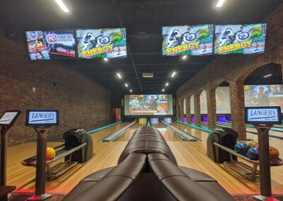 Bowling lanes with VersaLamps and projection systems